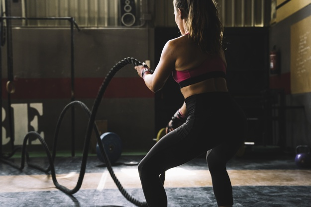 Woman Training With Rope Gym 23 2147675215